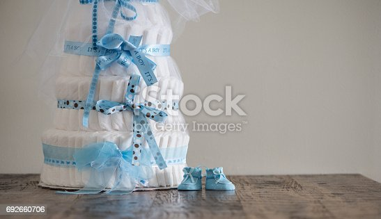 875685464 istock photo Diaper Cake A multi leveled diaper cake for a baby shower. 692660706