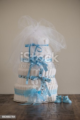 875685464 istock photo Diaper Cake A multi leveled diaper cake for a baby shower. 692660764