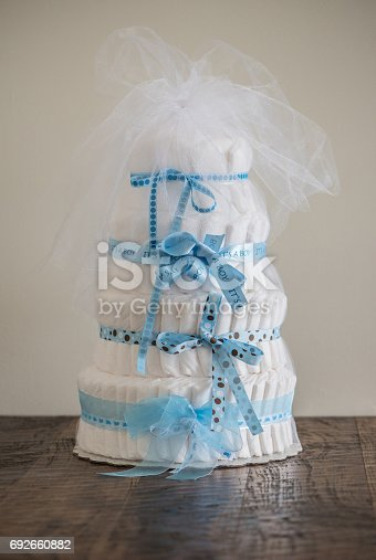 875685464 istock photo Diaper Cake A multi leveled diaper cake for a baby shower. 692660882