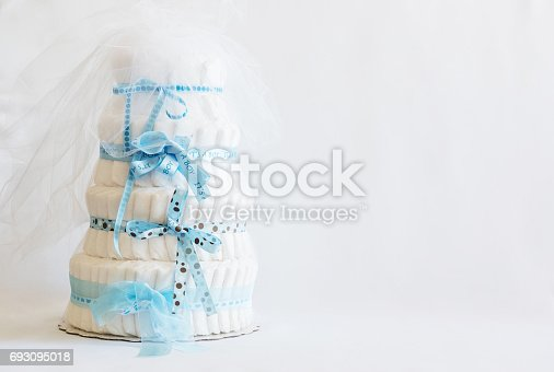 875685464 istock photo Diaper Cake A multi leveled diaper cake for a baby shower. 693095018