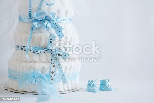 875685464 istock photo Diaper Cake and baby boy shoes for a baby shower. 693094868