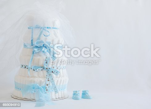 875685464 istock photo Diaper Cake and baby boy shoes for a baby shower. 693094910