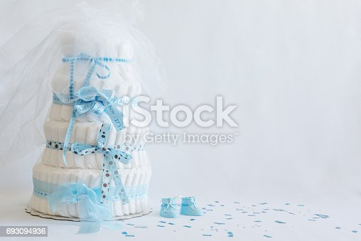 875685464 istock photo Diaper Cake and baby boy shoes for a baby shower. 693094936