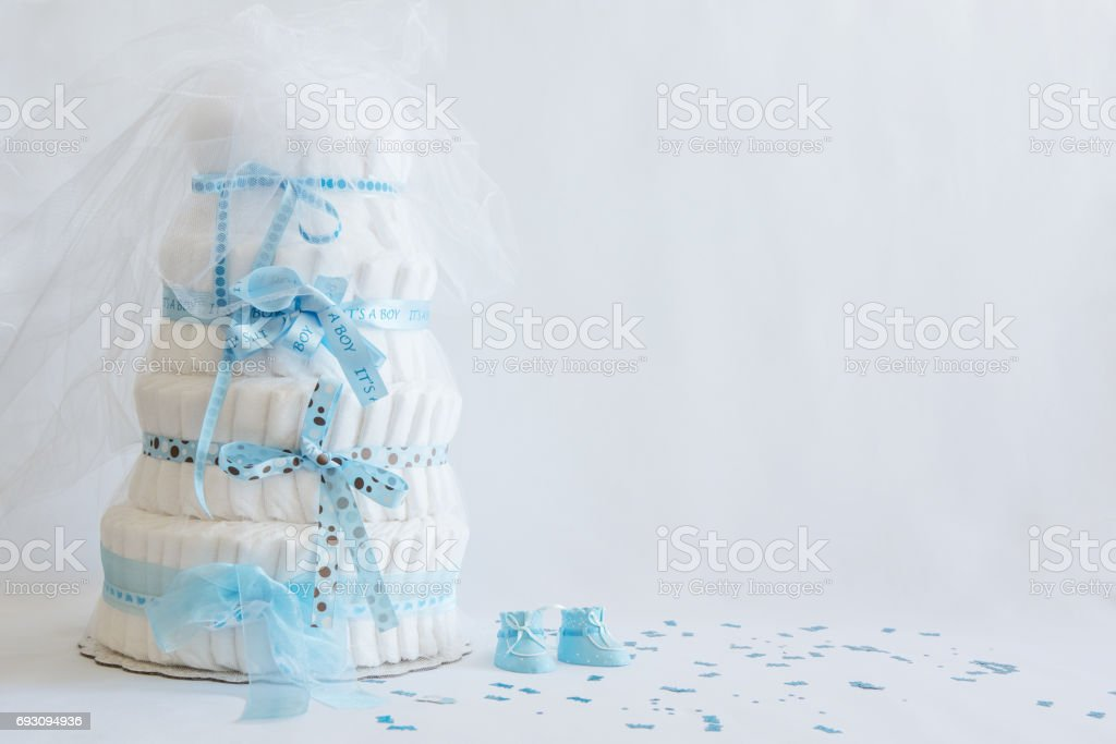 Diaper Cake and baby boy shoes for a baby shower. stock photo