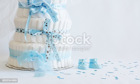 875685464 istock photo Diaper Cake and baby boy shoes for a baby shower. 693094968