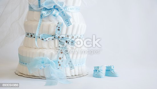 875685464 istock photo Diaper Cake and baby boy shoes for a baby shower. 693094986