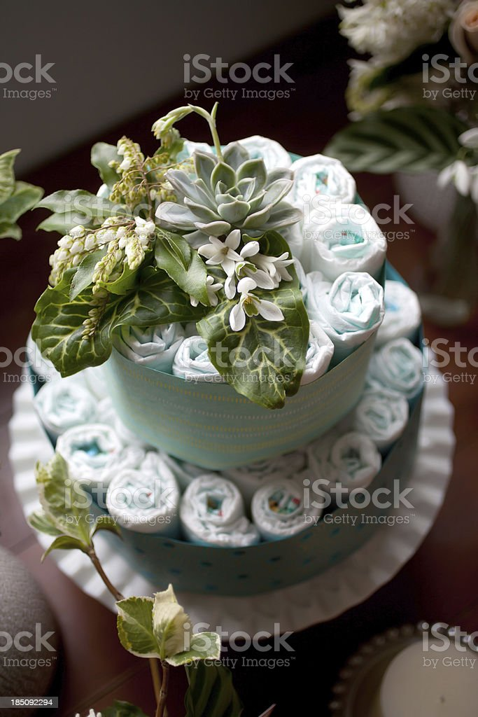 Diaper cake for baby shower covered in succulent flowers stock photo