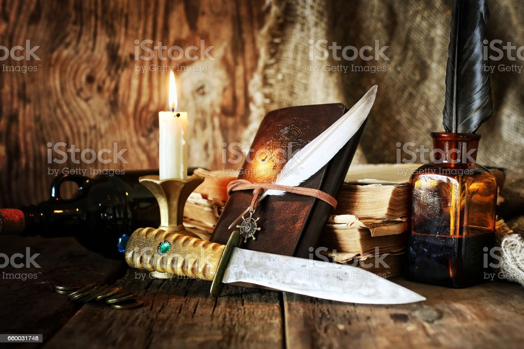 diary and feather with a bottle of rum stock photo