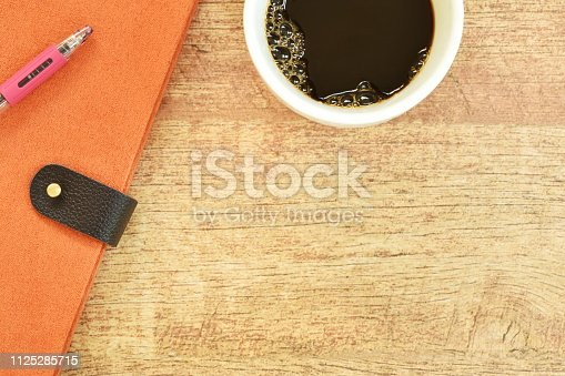 istock diary book and pen with coffee on table 1125285715