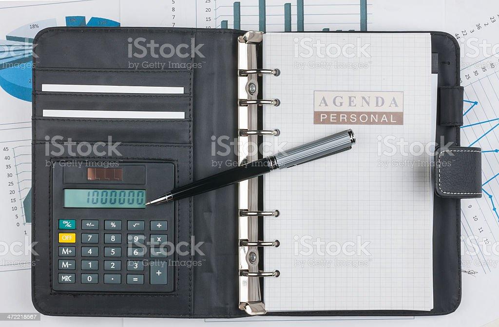 Diary, calculator and pen stock photo