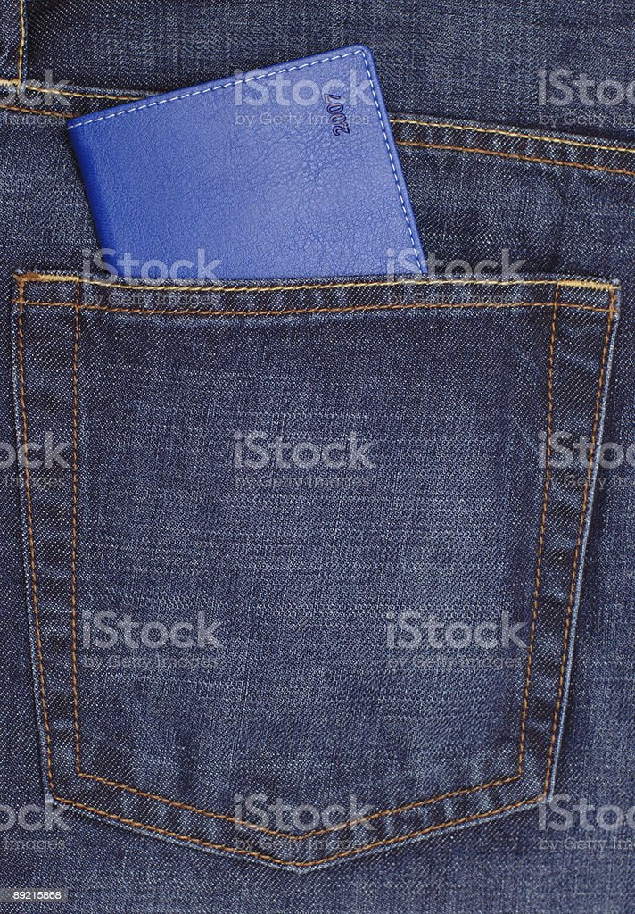 Diary in jeans pocket royalty-free stock photo