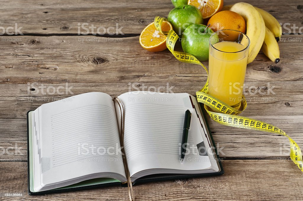 diary with fruit and a glass of fresh juice stock photo