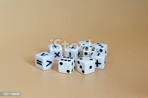 istock Dice and arithmetic operation symbol cubes on a soft brown background. 1031196692
