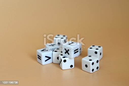 istock Dice and arithmetic operation symbol cubes on a soft brown background. 1031196736