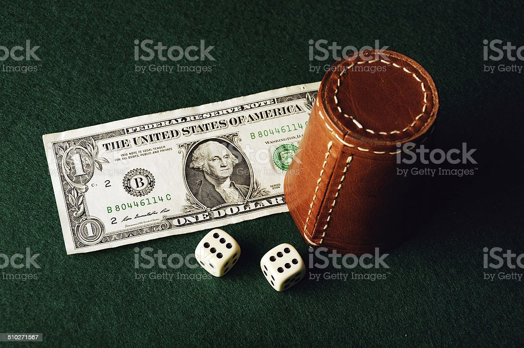 dice cup dollar stock photo