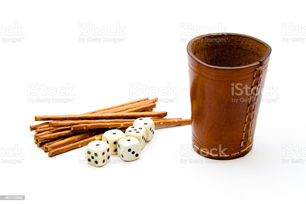 Dice cup with saltsticks stock photo