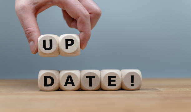 "Dice form the word ""UPDATE!"" while a hand rises the letters ""UP"". Dice form the word ""UPDATE!"" while a hand rises the letters ""UP"". update communication stock pictures, royalty-free photos & images"