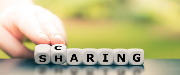"""Dice form the words """"caring"""" and """"sharing"""". stock photo"""