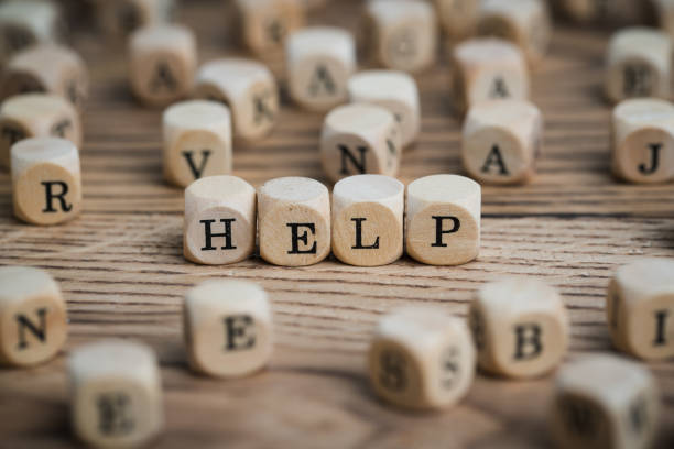 dice forming the word HELP dice forming the word HELP mental burnout stock pictures, royalty-free photos & images