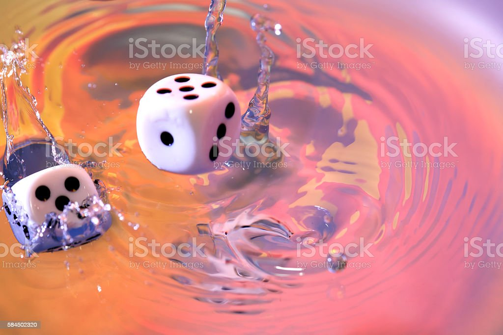 Dice Game In Water stock photo