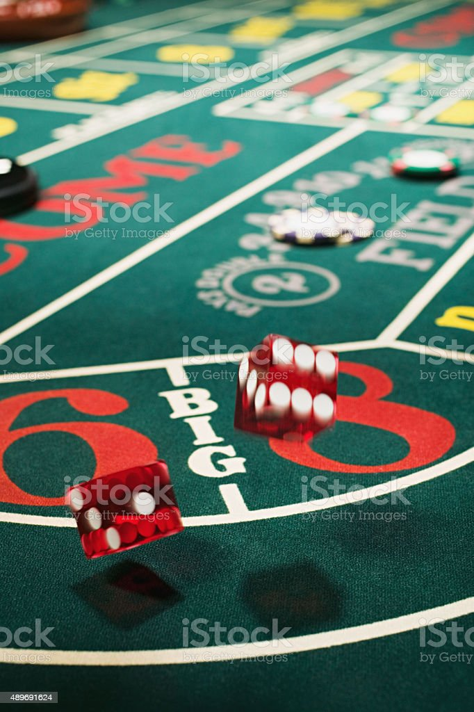 Dice on a craps table stock photo