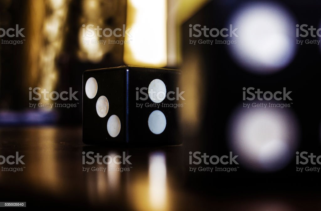 dice on a soft background color stock photo
