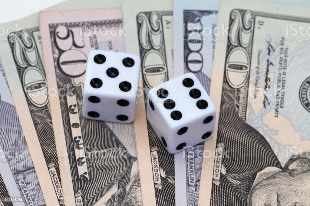 Dice on an array of USA currency stock photo