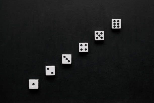 dice on blackboard - number 6 stock photos and pictures