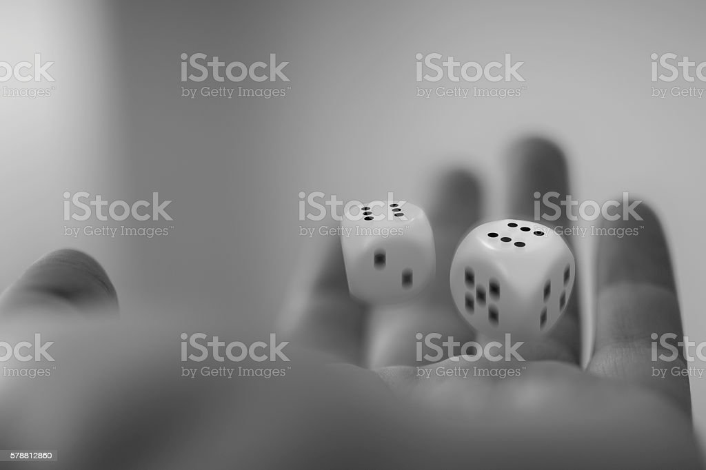 dice on  hand black and white stock photo