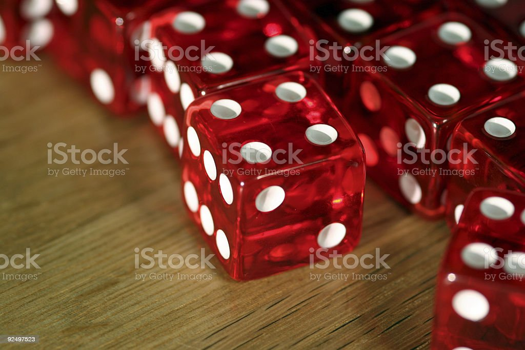 Dice on wooden table (macro) royalty-free stock photo