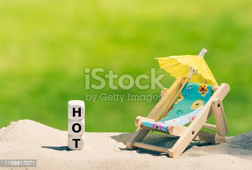 Dice placed next to a beach chair form the word