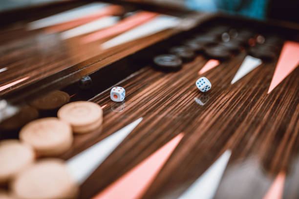 dice rolling on backgammon board - backgammon stock pictures, royalty-free photos & images