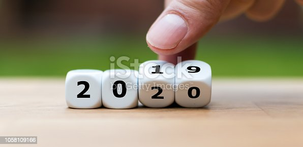 1186985932 istock photo Dice symbolize the change to the new year 2020 1058109166