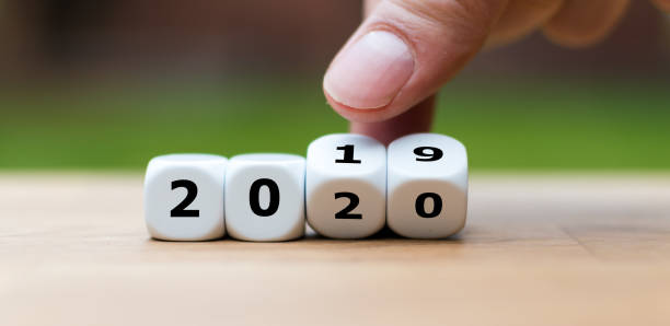 Dice symbolize the change to the new year 2020 stock photo