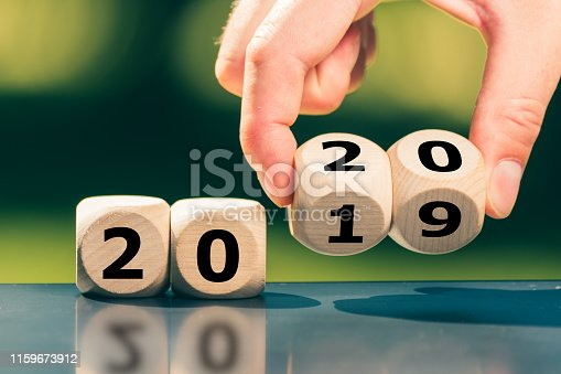 1186985932 istock photo Dice symbolize the change to the new year 2020 1159673912