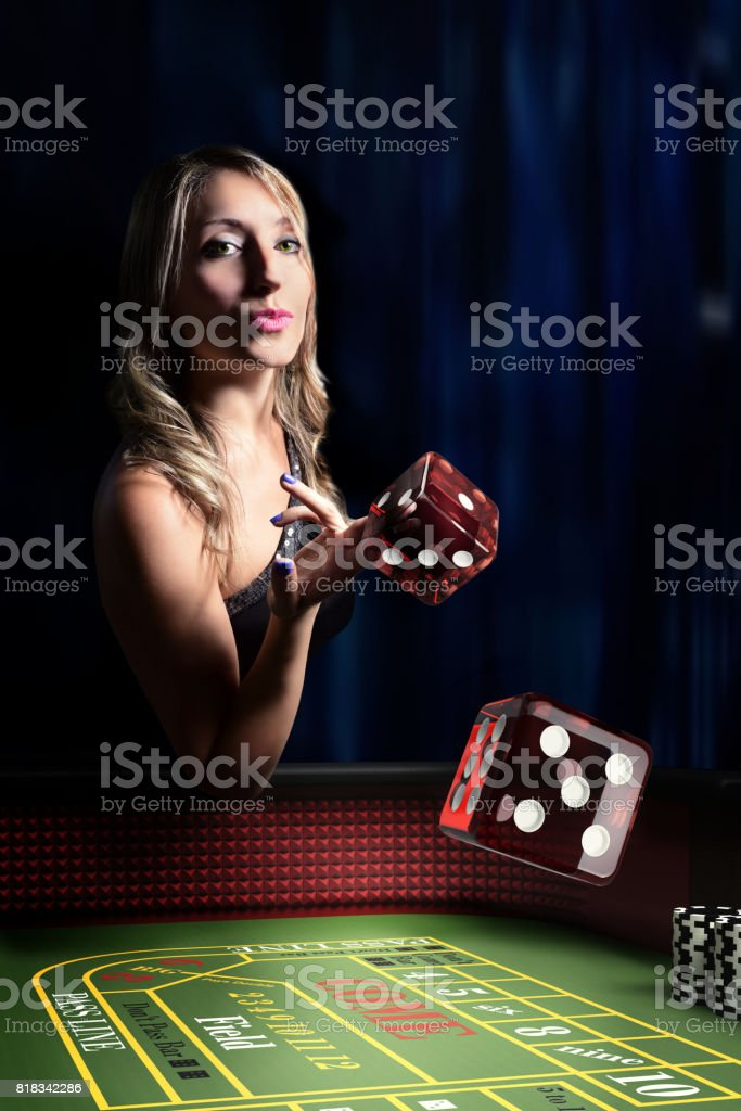 dice throw at casino table stock photo