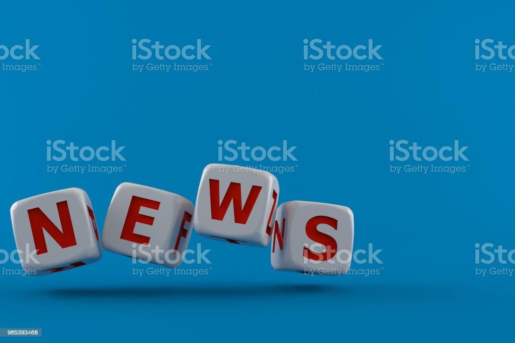 Dice with news text zbiór zdjęć royalty-free
