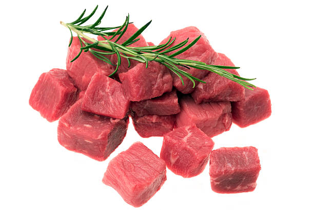 Diced beef Diced beef steak - studio shot on a white background beef stew stock pictures, royalty-free photos & images