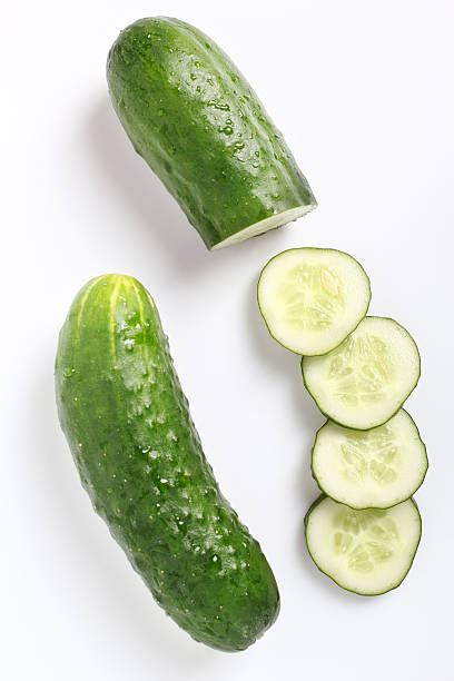 Diced cucumber. Isolated on a white background. Directly Above. stock photo