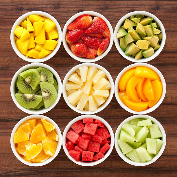 diced fruits Nine bowls containing different types of chopped fruits chopped food stock pictures, royalty-free photos & images