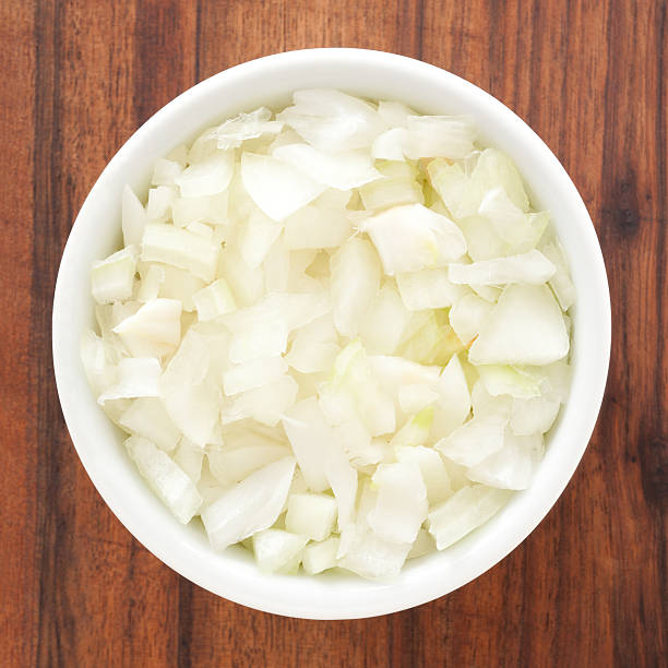 Diced onion Top view of white bowl full of diced onions chopped food stock pictures, royalty-free photos & images