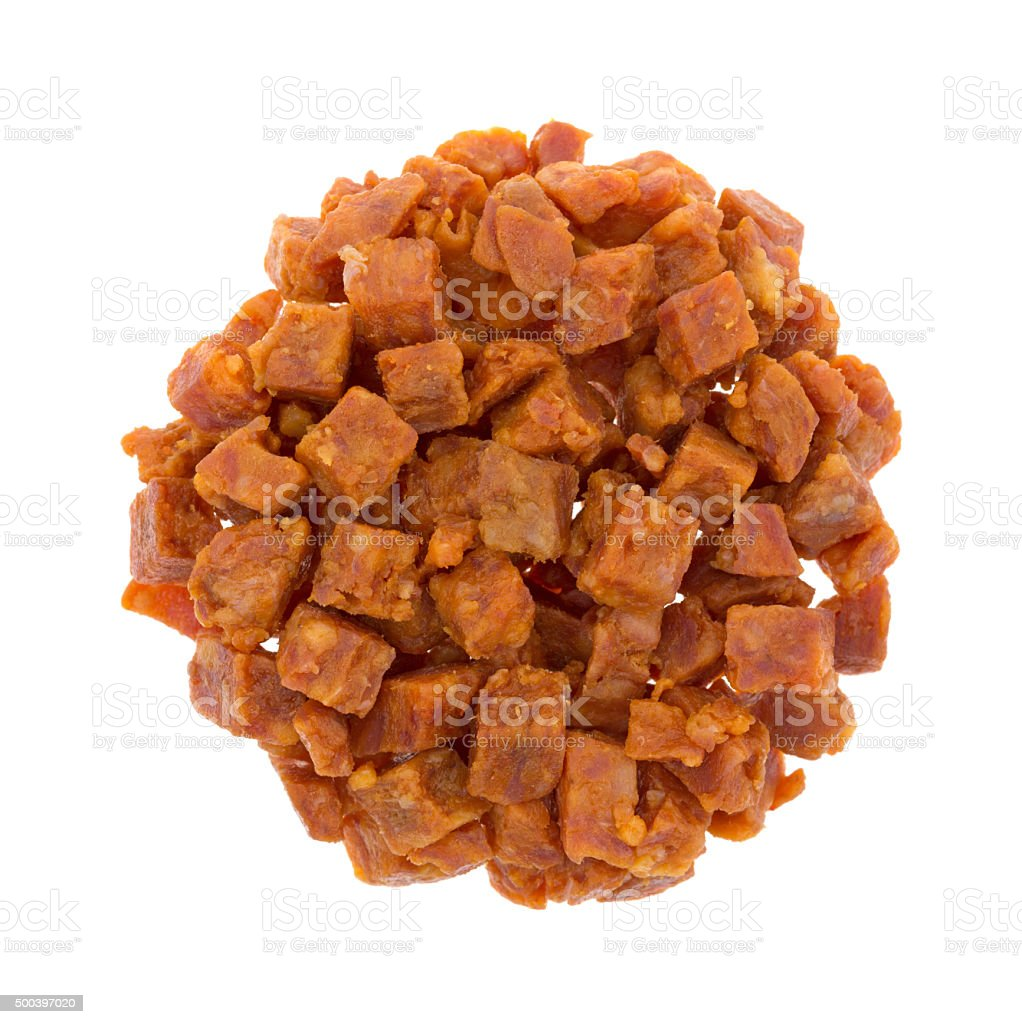 Diced pepperoni pizza topping on a white background stock photo