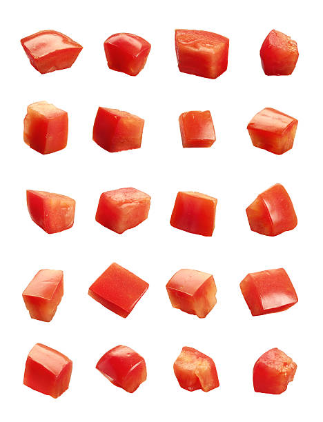 Diced Tomatoes isolated Diced Tomatoes isolated on white background chopped food stock pictures, royalty-free photos & images