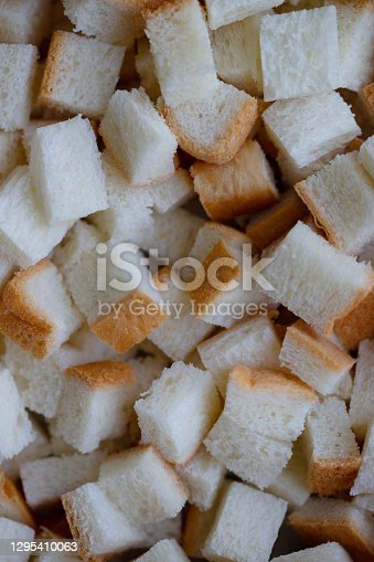 Diced white bread cubes background for homemade