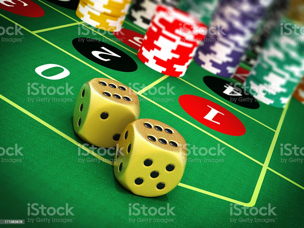 Dices and poker chips on green felt royalty-free stock photo
