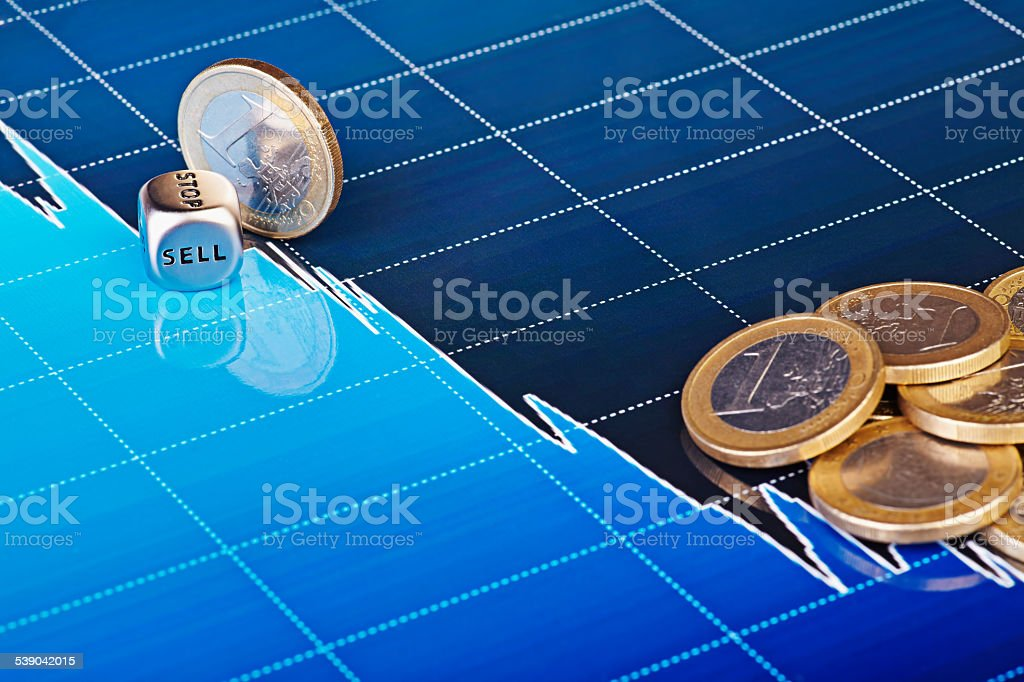 Dices cube SELL, one euro coin slides down stock photo