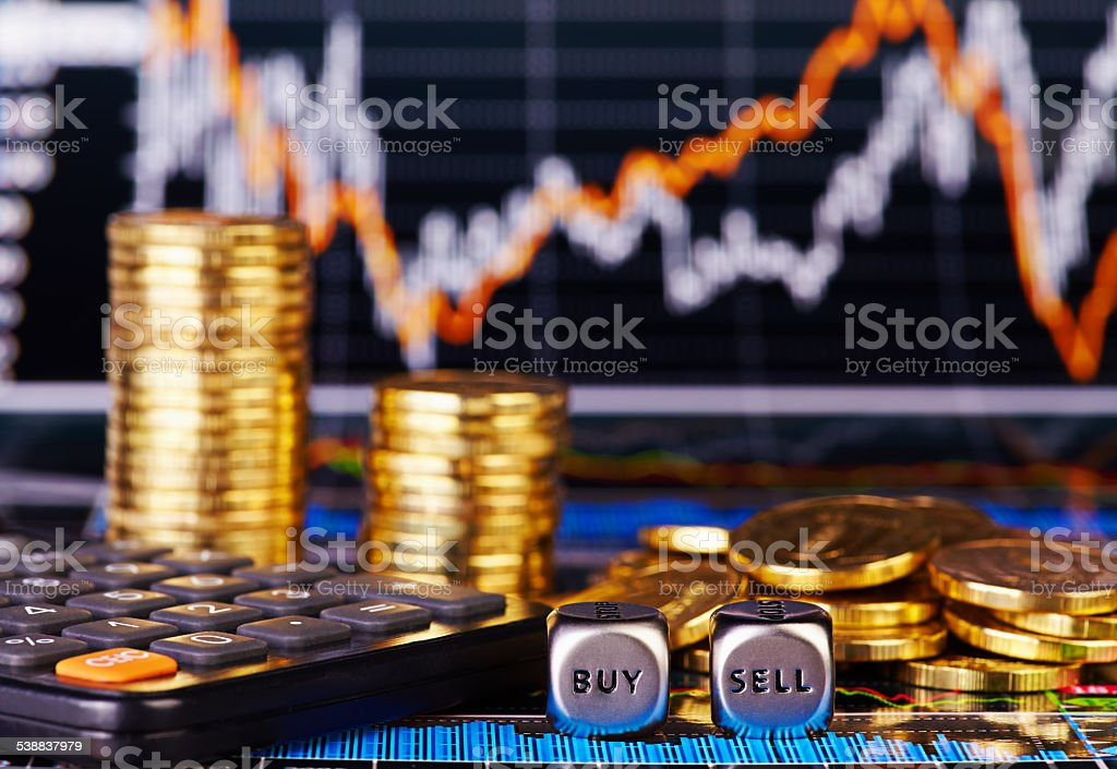 Dices cubes  SELL BUY golden coins, calculator and financial chart stock photo