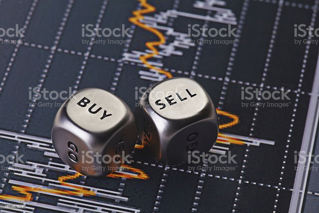 Dices cubes to trader. Dices cubes to trader. Cubes with the words SELL BUY. Selective focus Analyzing Stock Photo