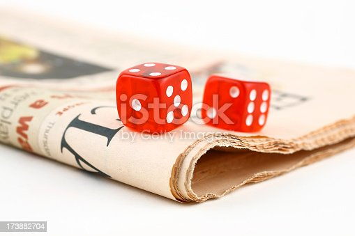 Dices on newspaper