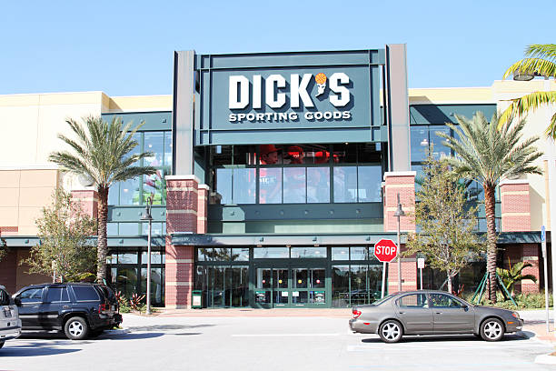 """Dick's Sporting Goods retail store in a south Florida mall """"West Palm Beach, Florida, USA - February 15, 2011: A Dicks Sporting Goods retail store in a south Florida strip mall. Several customer cars in the parking lot are visible in the foreground. Dicks Sporting Goods is a national chain that sells all types of sports, leisure and recreation supplies."""" Dick stock pictures, royalty-free photos & images"""